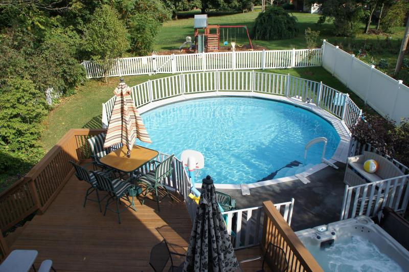 Lounge on deck overlooking the pool and hot tub.  Pool deck is gated for safety.