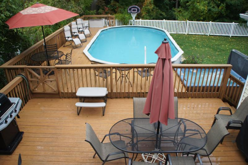 This yard has it all...large heated pool, large deck, hot tub, beautiful landscaping, and privacy.