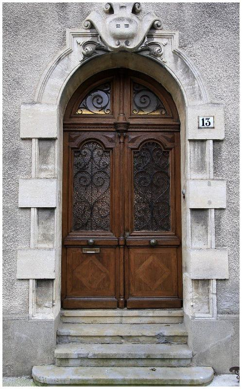 An imposing carved front door greets you as you arrive