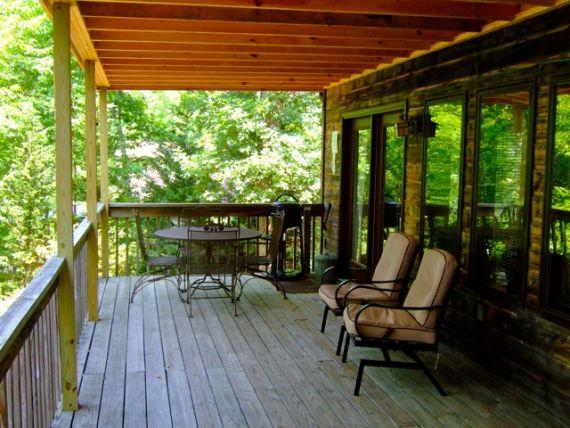 Upper deck with grill, porch rockers and patio furniture