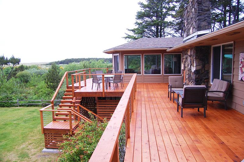 Fabulously huge deck has multiple spots to relax and entertain