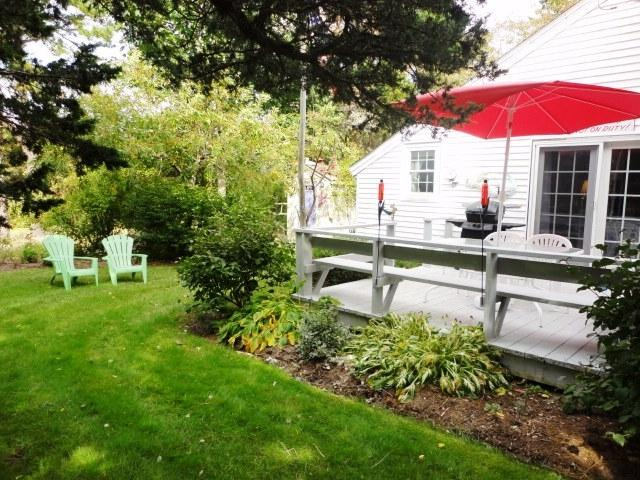 Side yard with deck and back yard