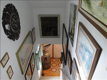Framed art down the staircase