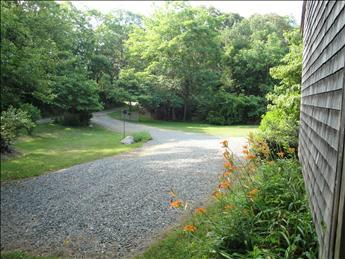 Long gravel driveway and priavte yard
