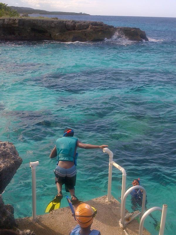 Jumping off into the sea at rear of Villa