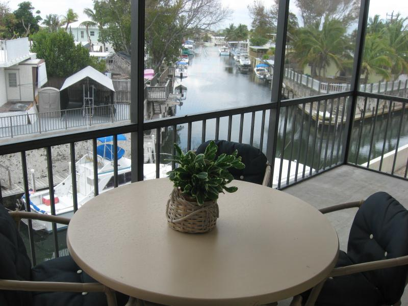 Screened Porch overlooking dock and canal