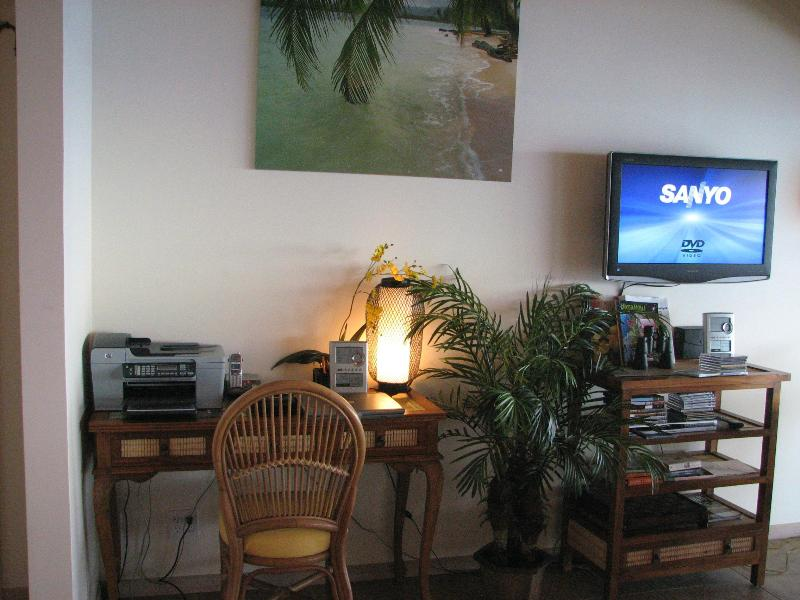 entertainment center with an office desk, wifi, tv, satellite, lots DVDs and Hawaiian music CDs.