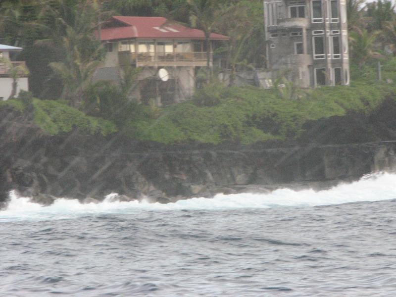 look at the house from the ocean on a boat