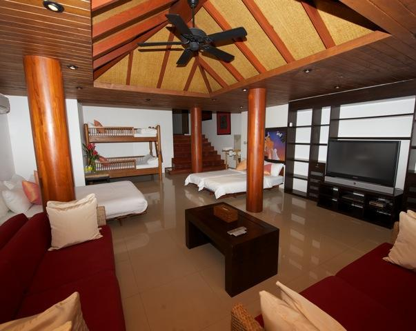 The family room (bedroom 4)  has a queen bed, two singles and bunk beds, as well as 3 baby cots