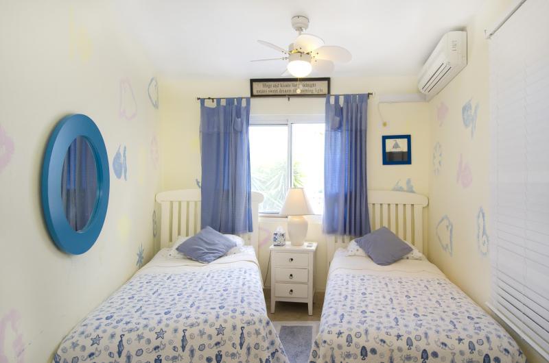 Lit chambre 4 jumeaux ou lit King