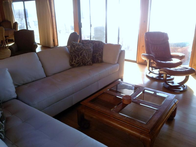 Large seating in front of entertainment section of Living Room
