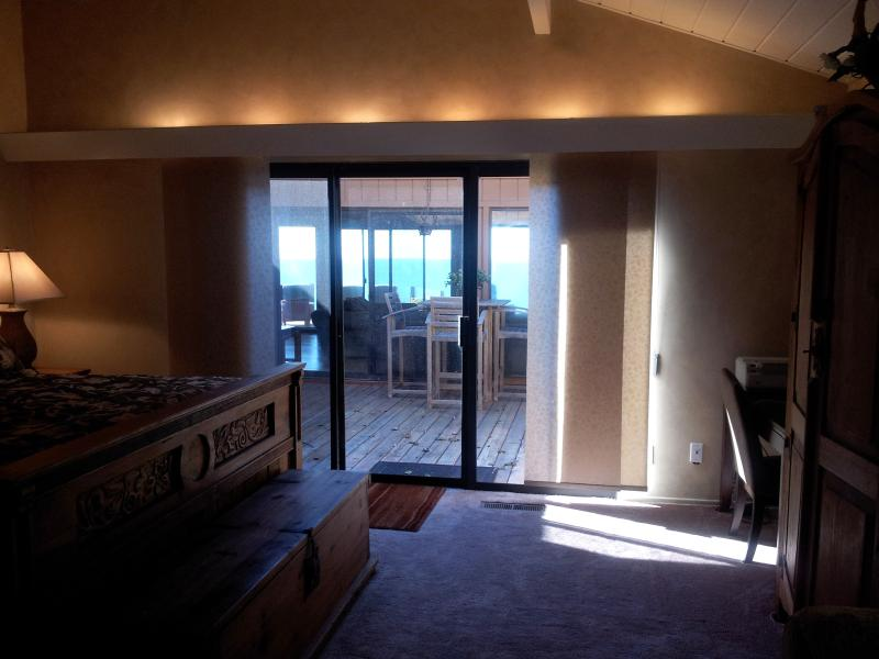 Ocean views from master bedroom. Seating in courtyard entry too