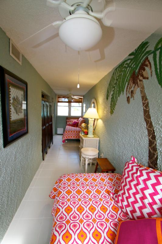 VIew of the Plus - 2 twin beds and a Palm Tree Mural