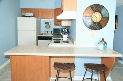 Kitchen bar area with stools for casual dining