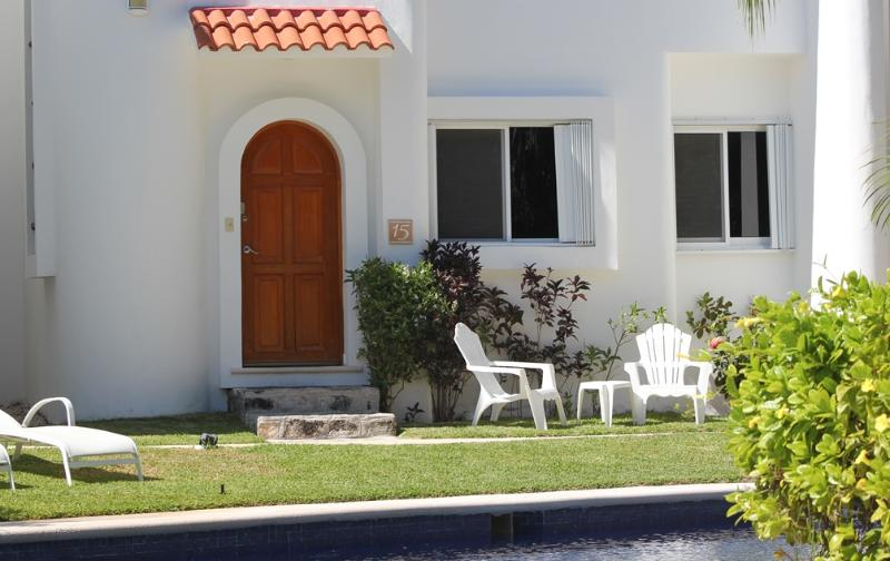 Relax by the front of the house and right next to the pool
