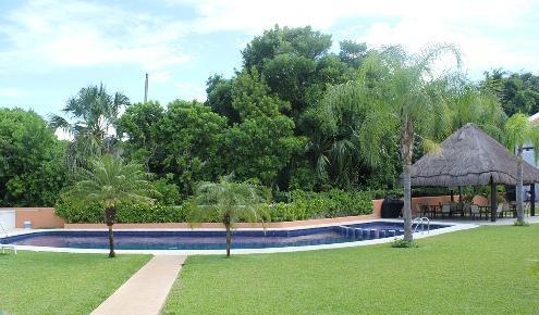 Large swimming pool backs onto Playacar bird sanctuary