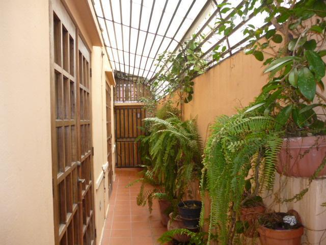 Passage from the entry hall to the casita's courtyard gate - at rear of house.