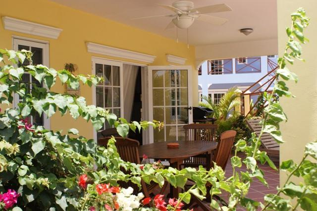 Front covered patio with comfortable furniture & BBQ
