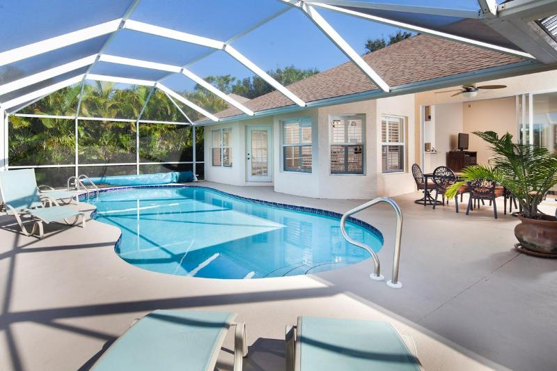 Large Heated Freeform Pool with Tiled Deck and Sunloungers