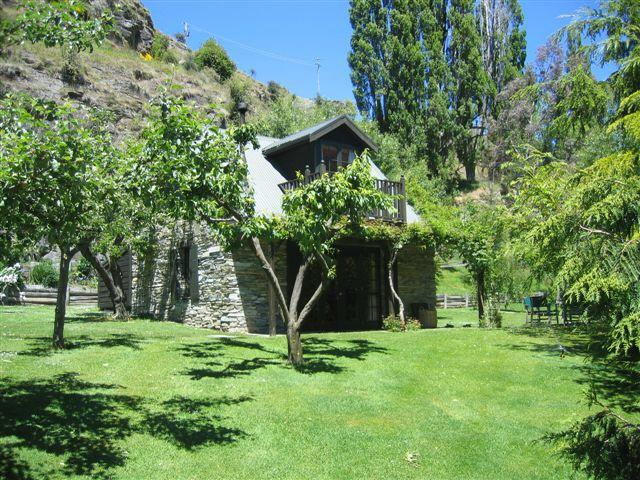 Self contained cottage separated from house by fruit trees. Private and sheltered.