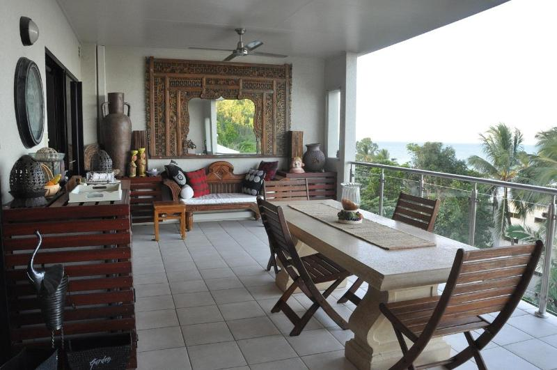 enjoy dining on the expansive balcony