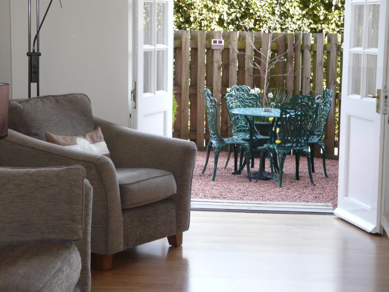 Lounge with French doors to private patio