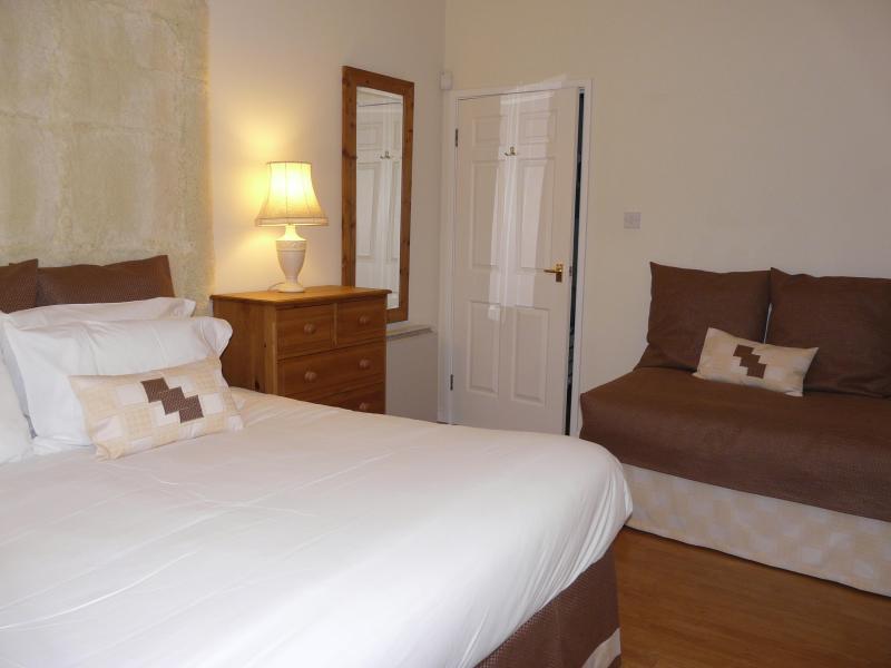 Bedroom showing extra bed, sleeping 3 people