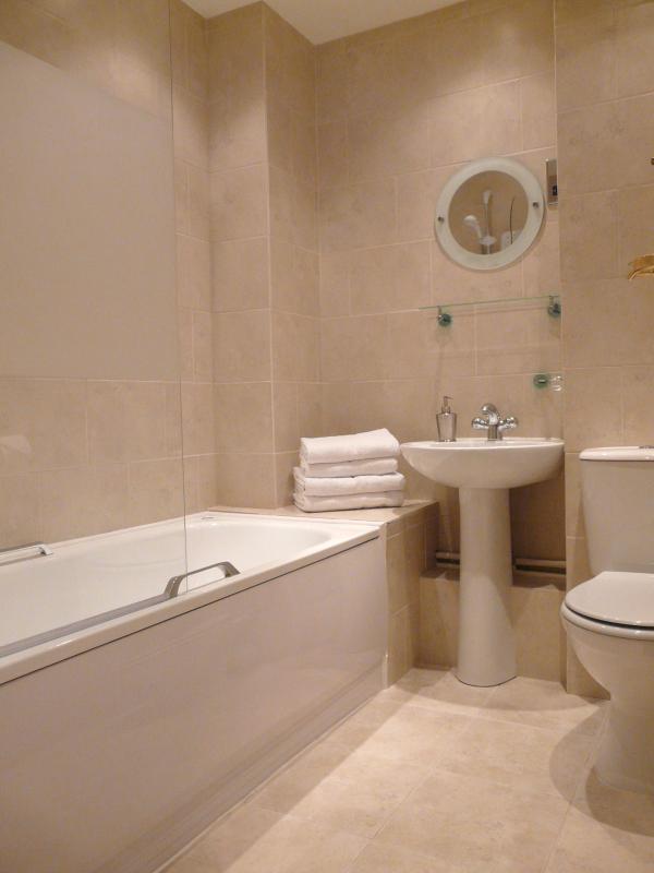 Bathroom with shower over bath