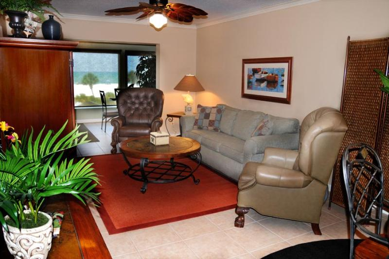 Living Area. Beach and Gulf  view as soon as you enter our beach front home. Sofa is a sleeper bed.