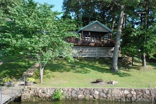 Lakeside of Property with Grass Yard and Easy Access to Water