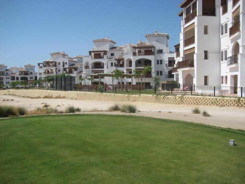 VIEW OF GOLF COURSE AND APARTMENT