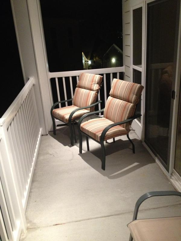 Porch with comfortable chairs to watch the golfers
