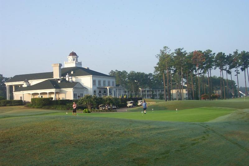 World Tour Putting Green and back of clubhouse