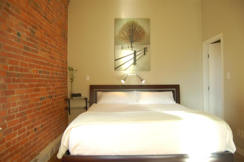 A King Size Bed For Your Comfort With Over The Bed Reading Lights