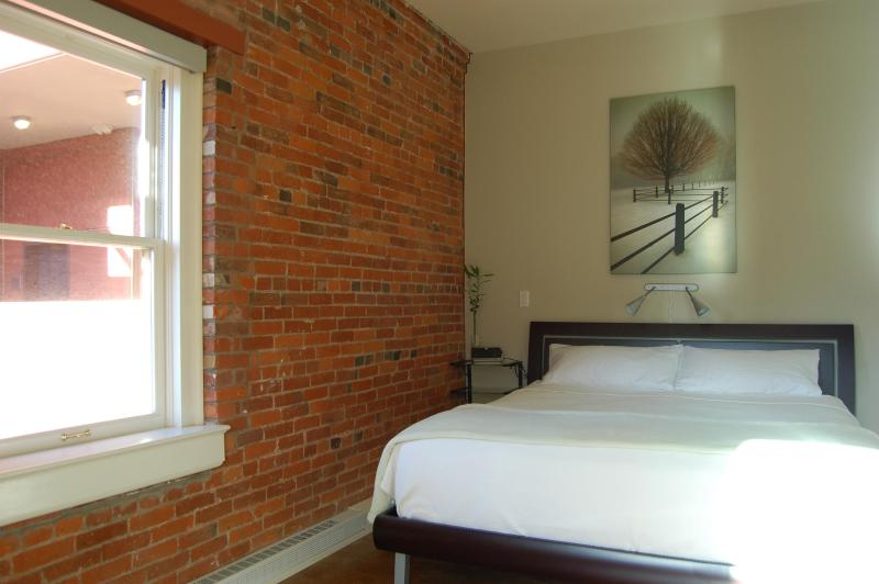 Awarehouse Has A King Size Bed & A Large Window For Your Comfort