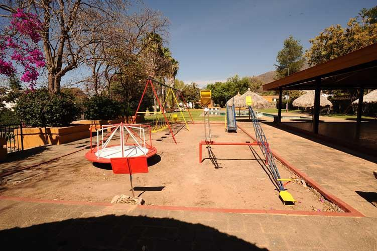 Rear park childrens' playground. Indoor and Outdoor games provided.