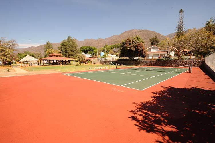 Rear park residents' tennis court. Tennis raquets and balls provided.