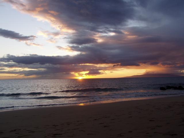 Zonsondergang schot van Charley Young strand