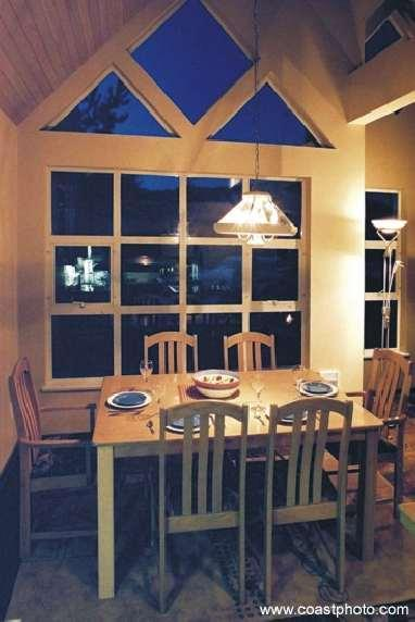 Oak furnished dining room has gas fireplace and mountain views.