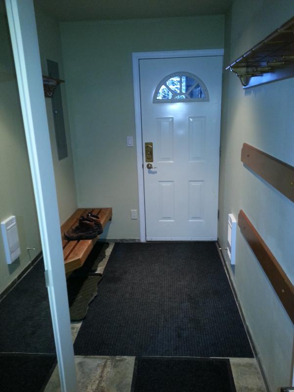 Heated ground floor entry hall has storage for ski gear and clothing.