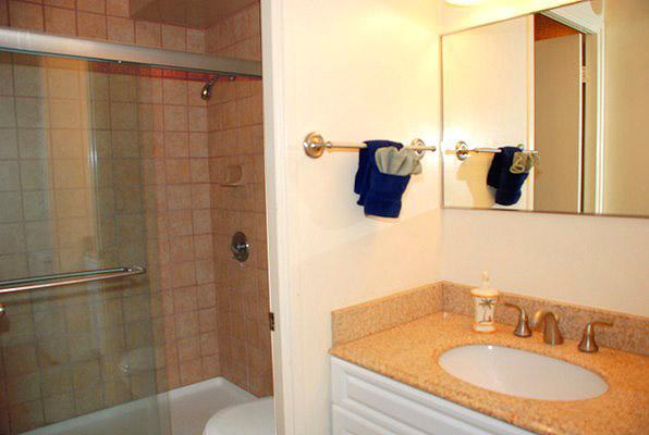 Bathroom and vanity, with shower.