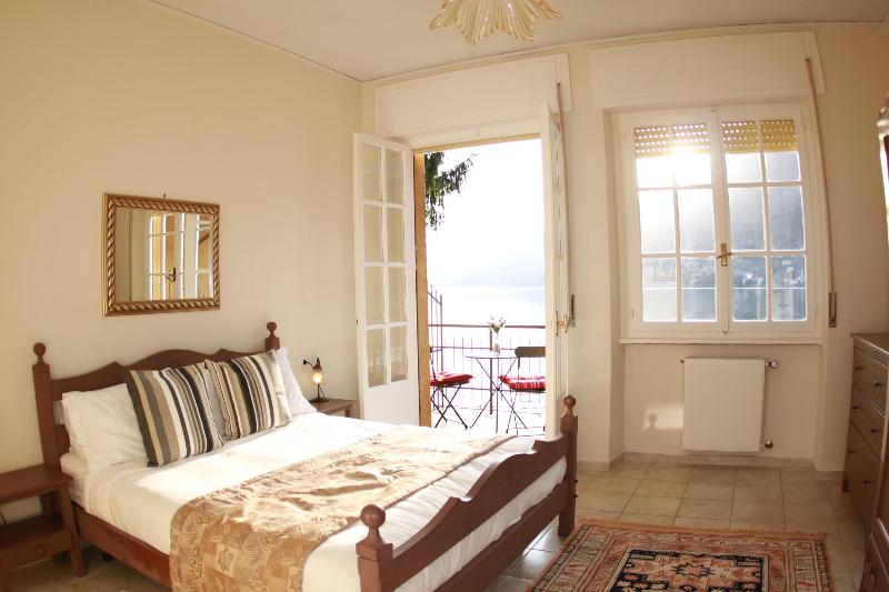 Warm Private Master bedroom with balcony and lake views