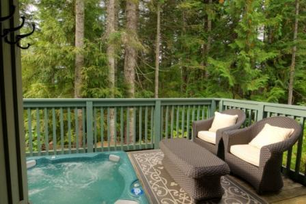 Partially covered deck with extra comfortable seating, private hot tub and BBQ.