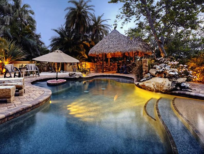 Lagoon and tiki hut,waterfall,swim up table, beach entry and baja ledge