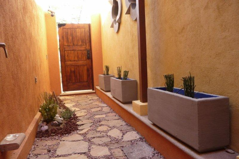 Private garden and entrance with outdoor shower outside the downstairs masterbedroom