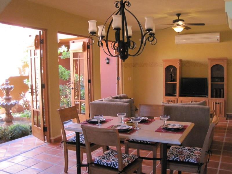 Spacious living room and dining room adjoin the interior courtyard garden.