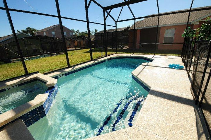 Pool/spa with safety fence.  Outside table and chairs not shown.