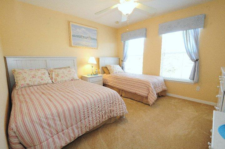 Beach room with full bed and twin bed.  Shared full bath in hall.