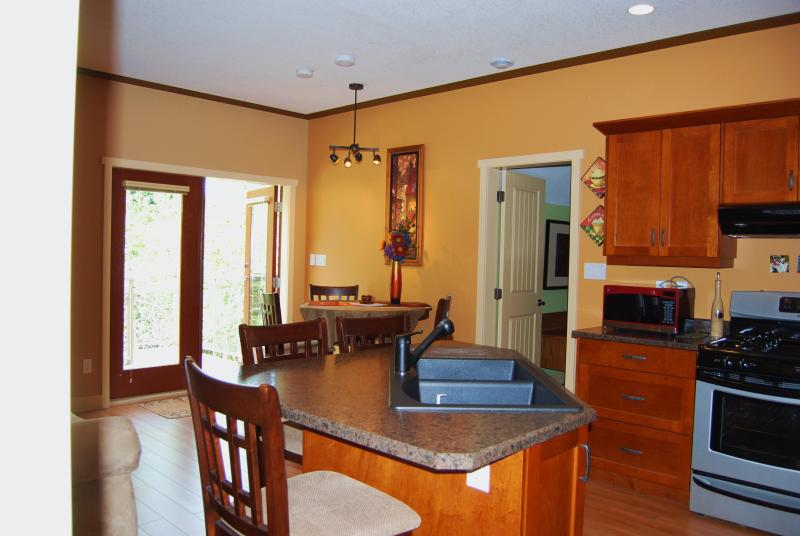 Dining area, french doors to upper deck