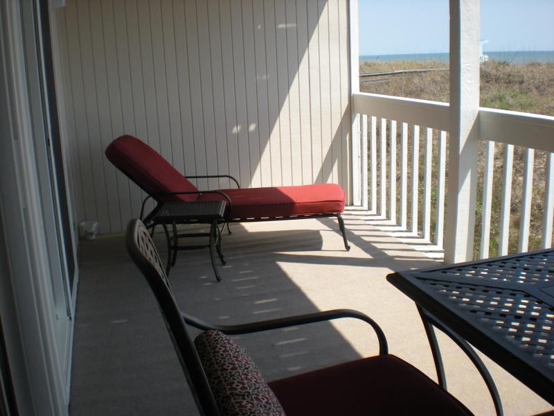 CHAISE LOUNGE AND TABLE ON BALCONY DECK WITH CARPET